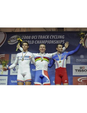 Britain's Chris Hoy (C) celebrates his win with France's Mickael Bourgain (R) and Kevin Sireau.