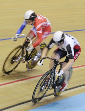 America's Jennie Reed battles Britain's Victoria Pendleton in the sprint.