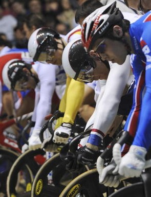 Russia's Sergei Ruban (R), Hoy (2ndR) line up in the first heat of the men's Keirin first round.