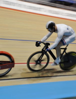 Britain's Chris Hoy (C) follows the derny motor-pacer (L) during the men's Keirin first round.