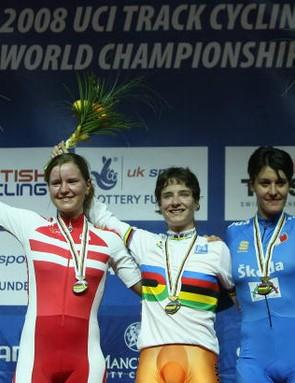 Marianne Vos (C) celebrates with Trine Schmidt (L) of Denmark (Silver) and Vera Carrara (R).