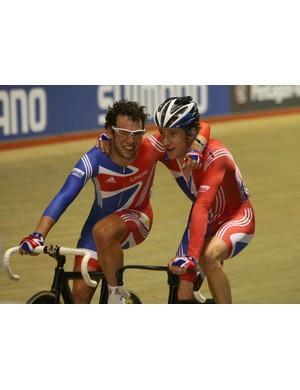 Britain's Mark Cavendish (L) and Bradley Wiggins celebrate gold in Manchester.