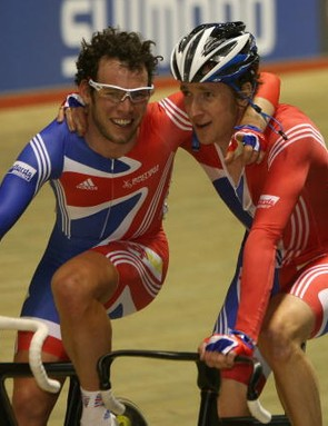 Britain's Mark Cavendish (L) and Bradley Wiggins celebrate gold in Manchester.