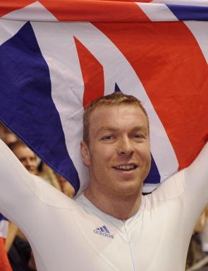 World Keirin champ Chris Hoy holds up the Union Jack Saturday in Manchester.