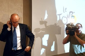 French Sports Minister Bernard Laporte (L) gives a phone call before the press conference.