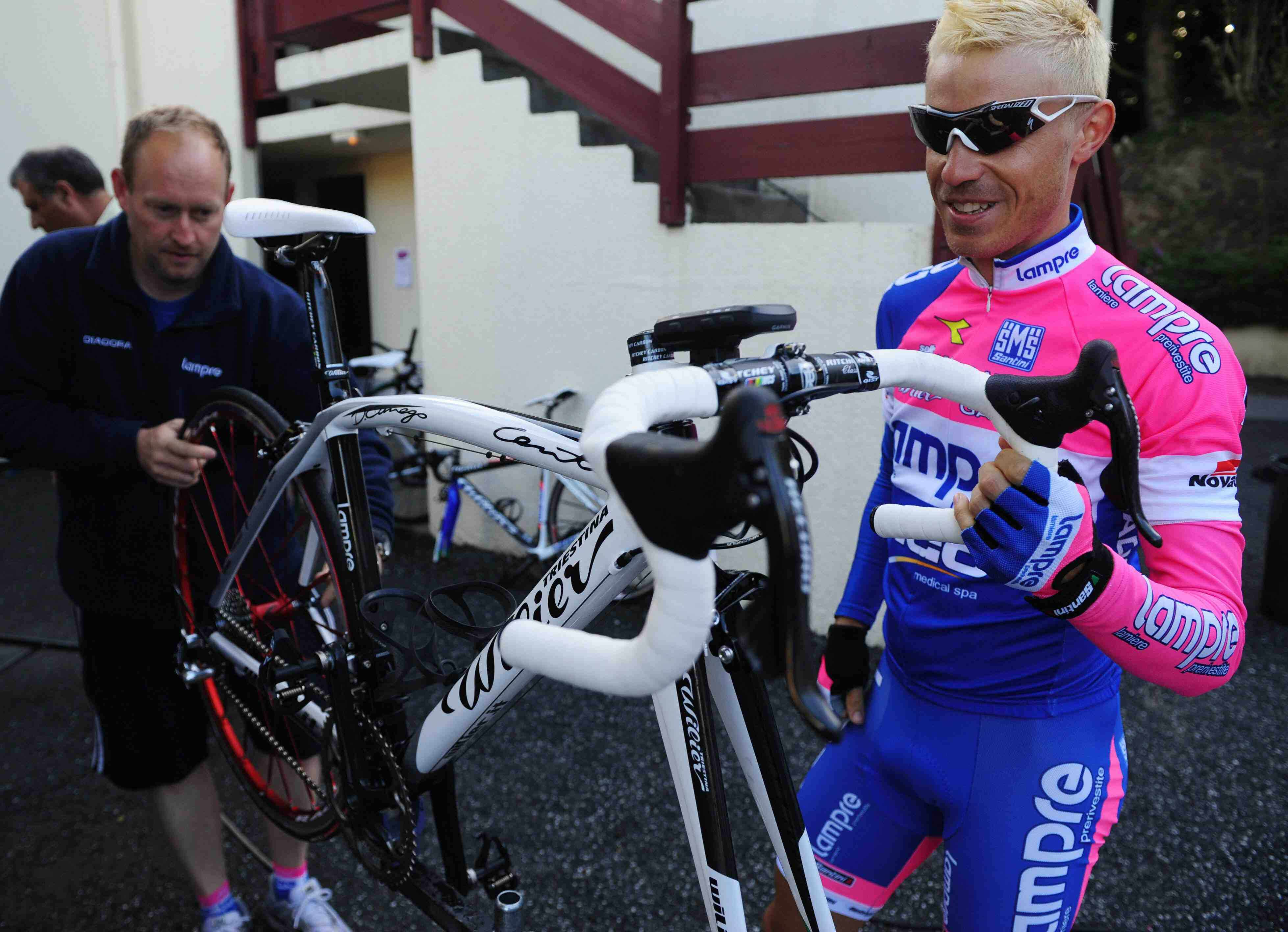 Damiano Cunego makes sure everything's just right, including his blonde locks.