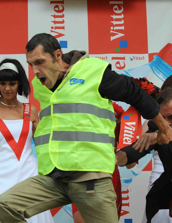 Hinault shoves a plucky protester off the podium July 7 in Nantes, France...