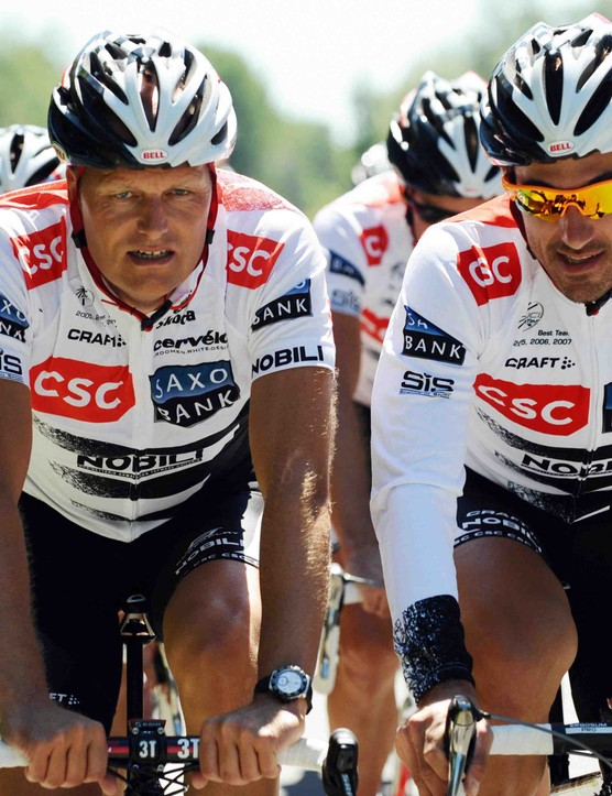 CSC team boss Bjarne Riis (L) likes having Fabian Cancellara on the team.
