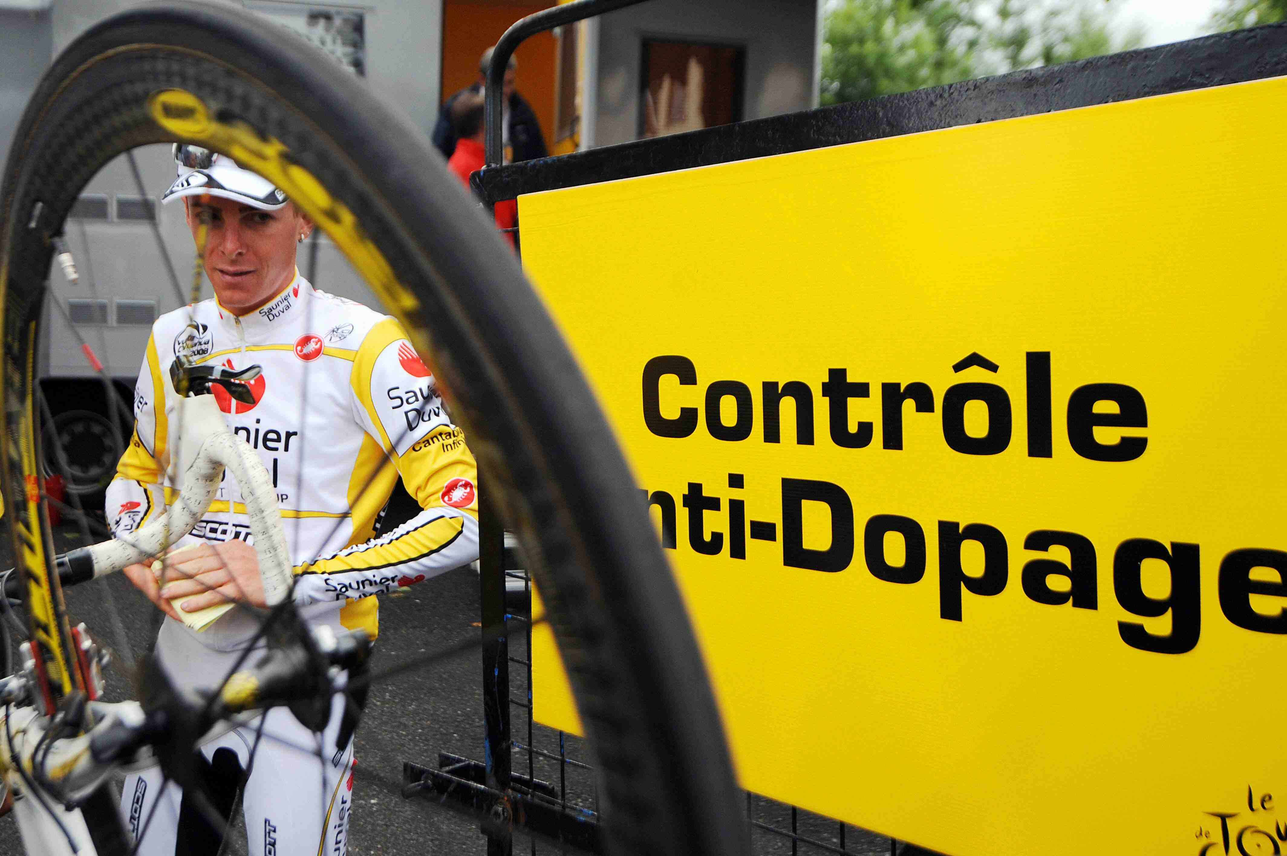 Italian climber Riccardo Ricco leaves the anti-doping control after winning Stage 9.