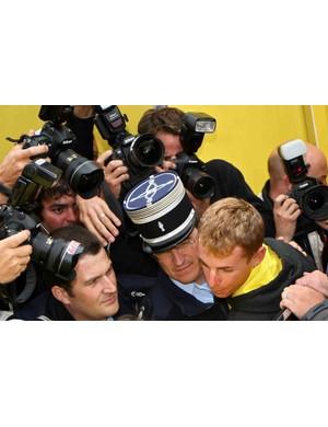 Disgraced Saunier Duval Scott rider Riccardo Ricco heads to the police station Thursday.