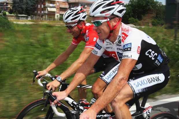 Stuart O'Grady (R) of Australia and Team CSC trains with Niki Sorenson of Denmark during the second rest day of the 2008 Tour de France.