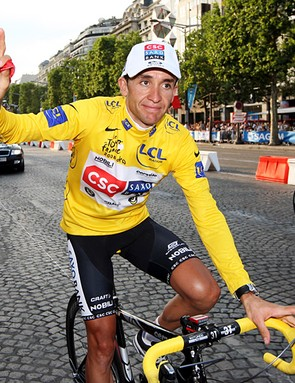 Sastre rides down the Champs Elysees after winning the Tour de France
