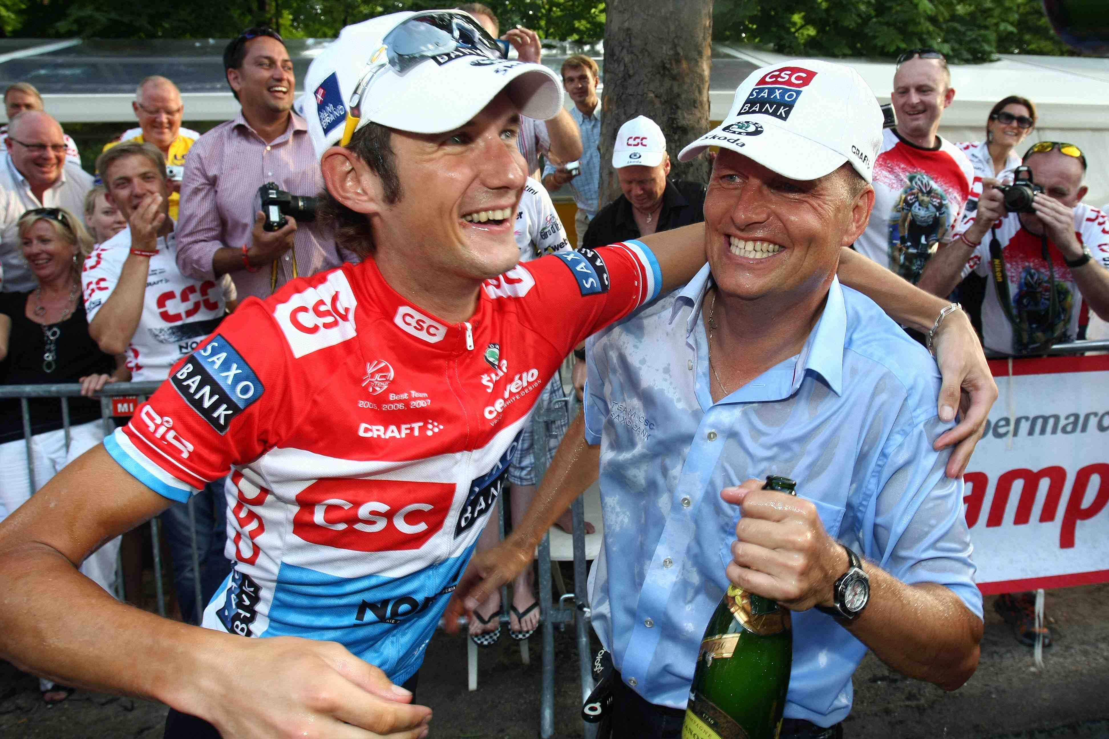 Team CSC's Frank Schleck and manager Bjarne Riis celebrate in Paris.