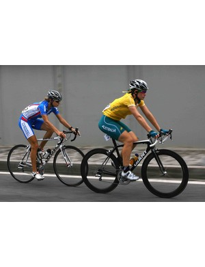 Kate Bates of Australia rides ahead of Alexandra Burchenkova of Russia during the women's road cycling event Aug. 10.