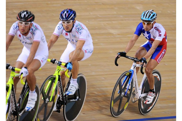 Members of the Italian and Chilean track teams warm up recently.