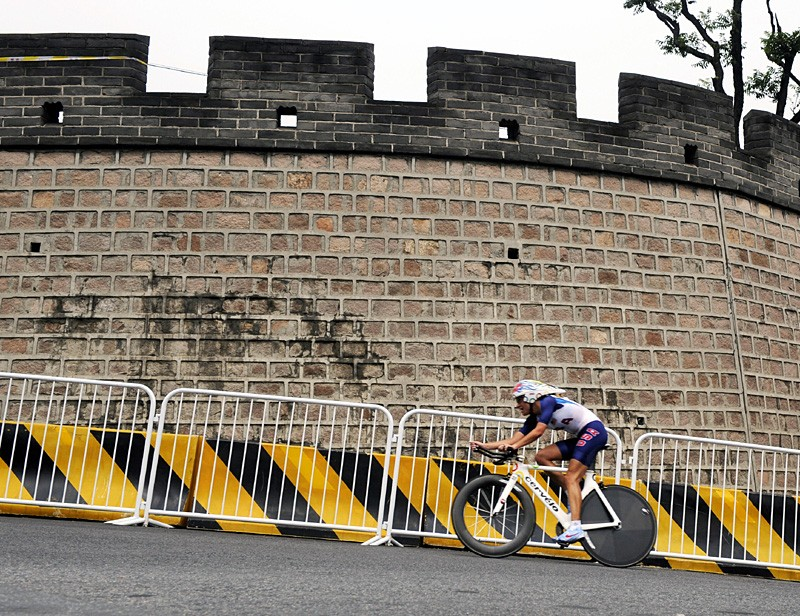 Women's time trial winner Kristin Armstrong passes the Great Wall