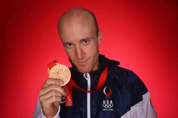 American cyclist Levi Leipheimer shows off his bronze medal from the Beijing Olympic time trial in August.