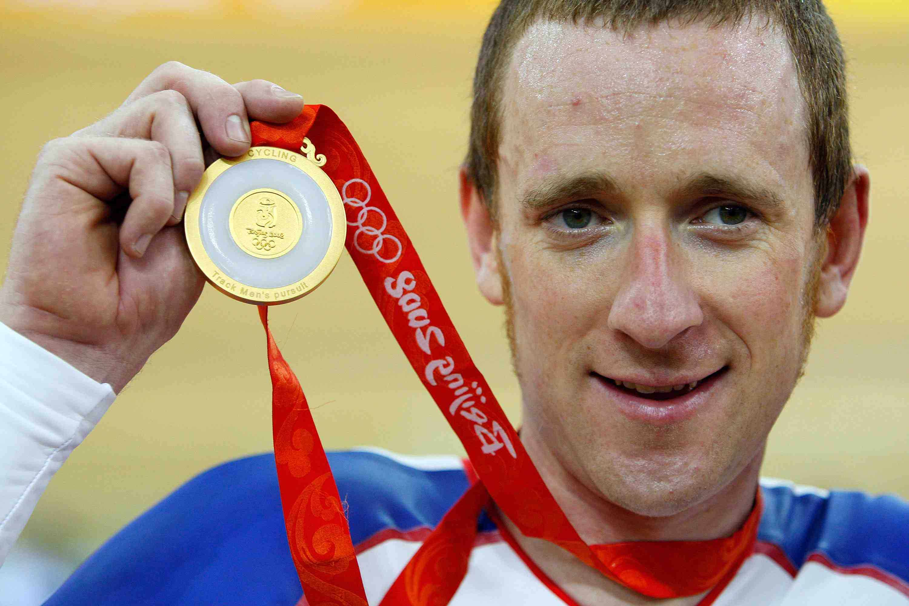 Britain's Bradley Wiggins likes the feel of gold around his neck.