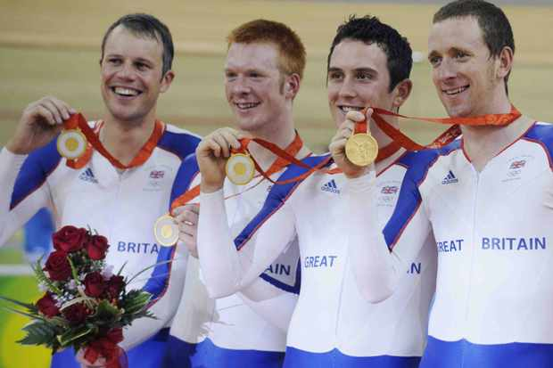 Great Britain's track cyclists Paul Manning, Ed Clancy, Geraint Thomas and Bradley Wiggins pose with their gold medals after winning the team pursuit.