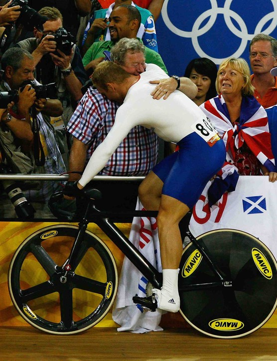 Chris Hoy celebrates after winning his third gold in Beijing.