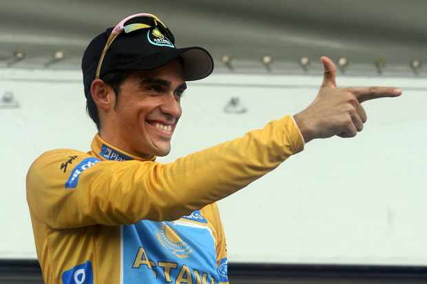 Alberto Contador of Astana celebrates at the podium as winner of 'La Vuelta'