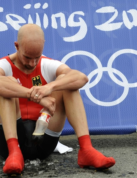 Stefan Schumacher sits down after his time trial at the Beijing Olympics, where he finished 13th