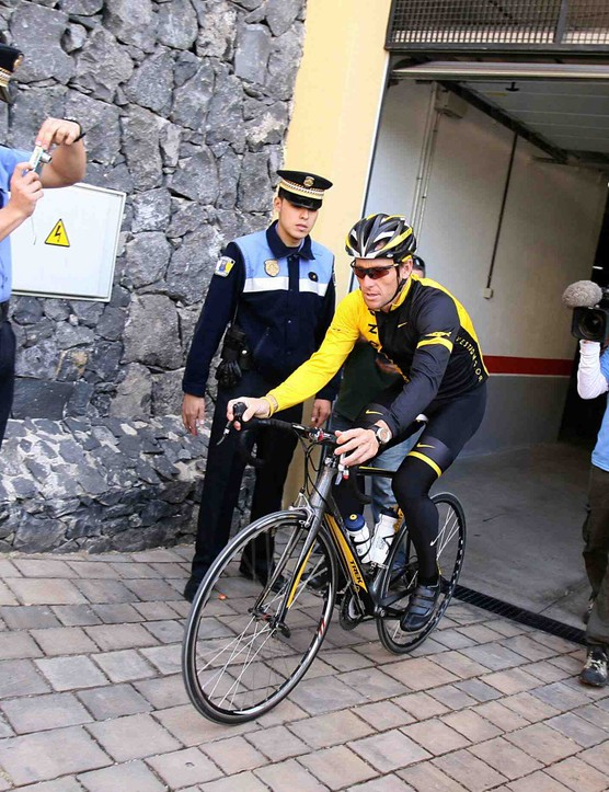 Lance Armstrong gets our vote for most photographed person of the past three months. He doesn't seem to object.