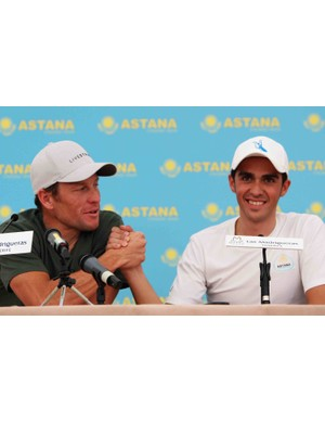 Lance Armstrong of the USA shakes hands with team mate Alberto Contador of Spain during a Team Astana Training Camp press conference at the Hotel Las Madrigueras on December 4, 2008 in Playa de las Americas, Tenerife.
