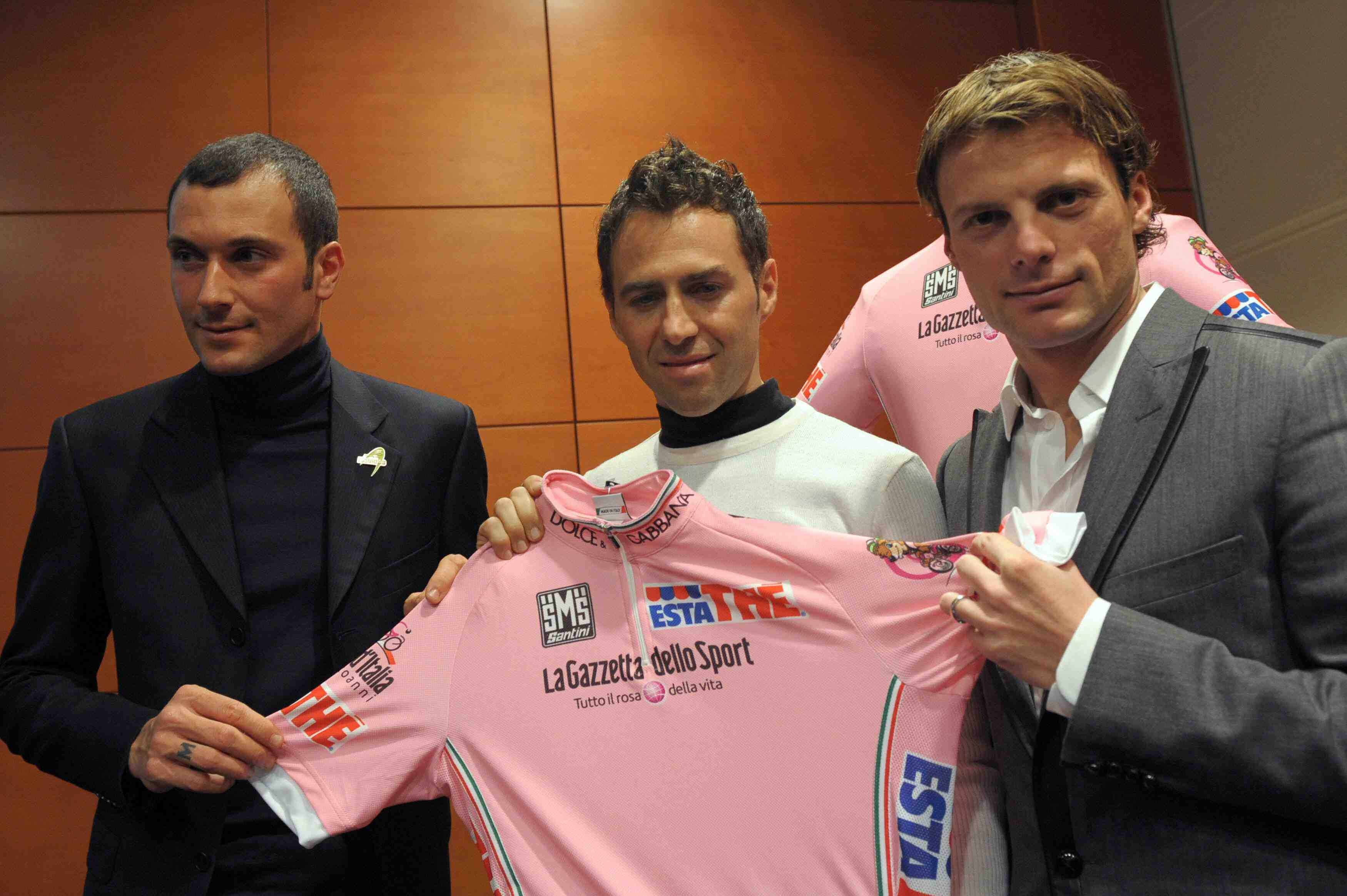 Former Giro winners Ivan Basso (2006), Gilberto Simoni ('01 and '03) join Danilo Di Luca ('07) during the presentation of the 100th anniversary of the leader's pink jersey on the eve of the official 2009 race presentation.