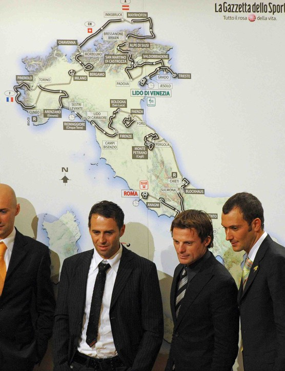 Italian bicycle racers Stefano Garzelli, Gilberto Simoni, Danilo Di Luca and Ivan Basso pose in front of a poster showing the route of the 100th Giro d'Italia (Tour of Italy) during its presentation on December 13, 2008 at the Fenice Theatre in Venice.