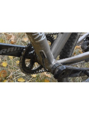 Internally routed cables exit the down tube near the bottom bracket and keep the main triangle cable free for easy shouldering