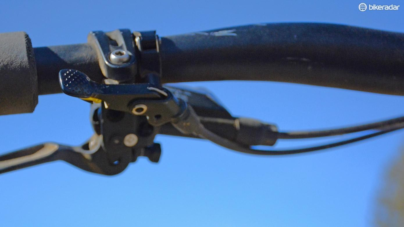 The remote nests very nicely with Shimano brakes