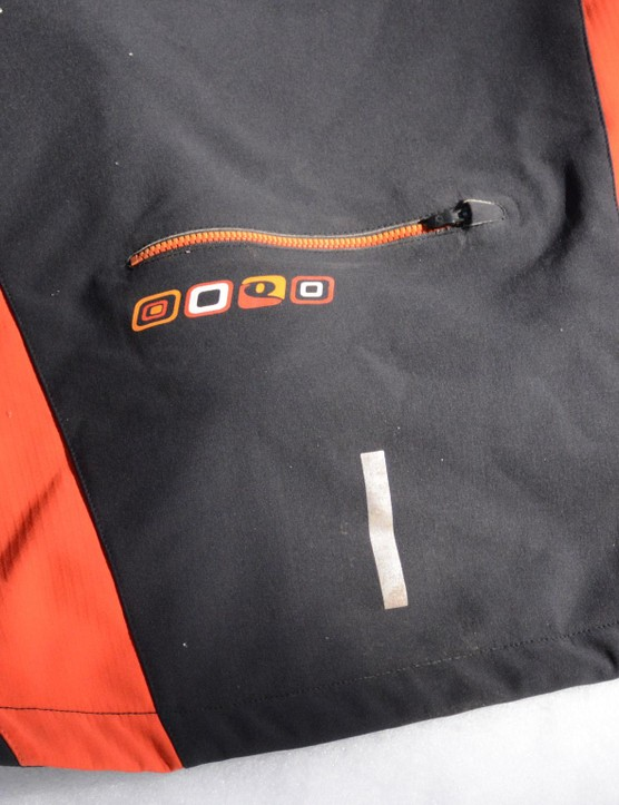 A large, zippered pocket and a small reflective detail reside on the back