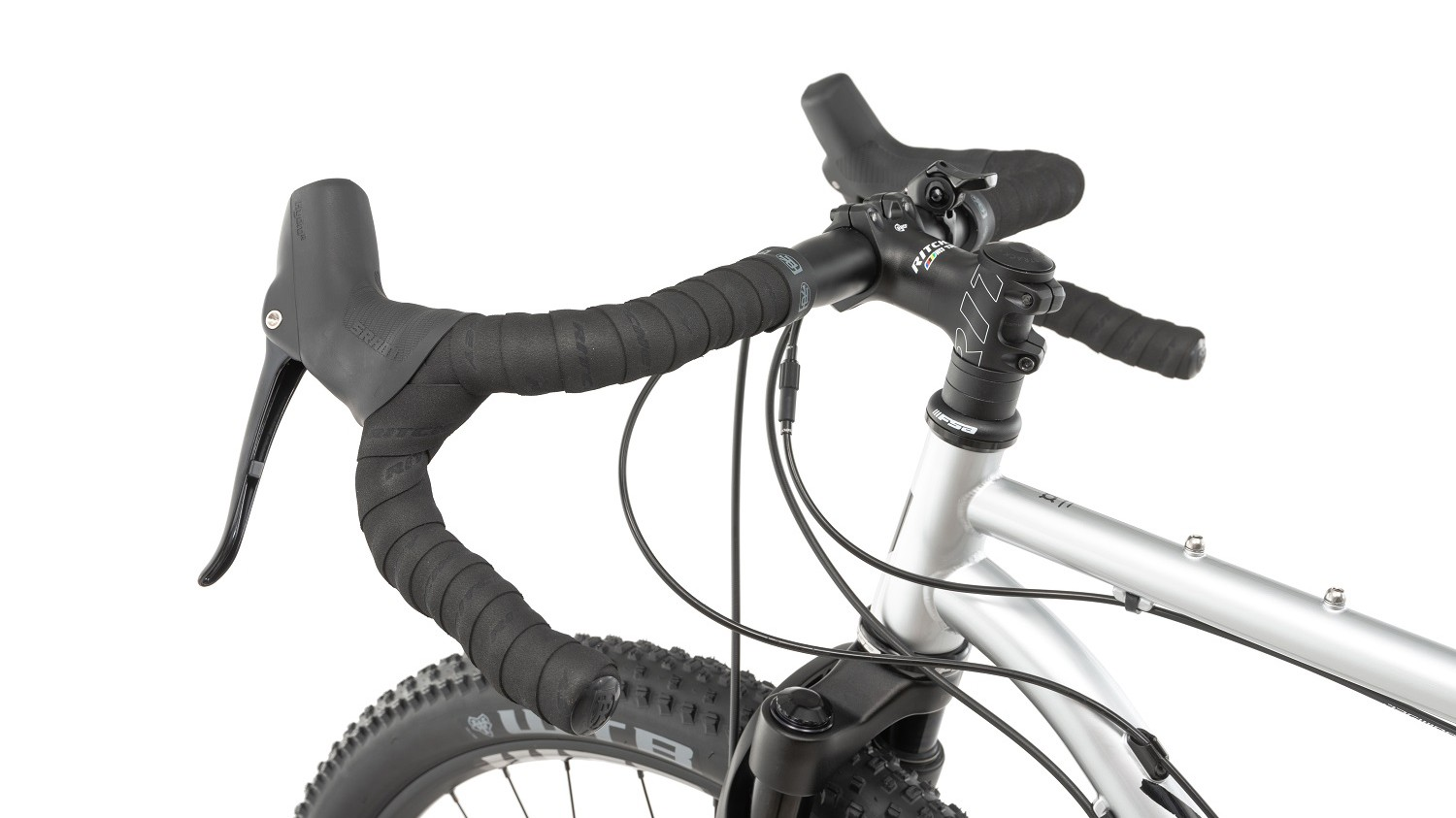 The dropper lever is attached to the clamping area of the bars