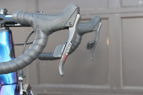 You need both hands on the shifters to move either derailleur both directions