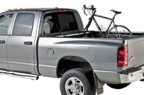 There's a better way than just laying your bike in the back of your truck