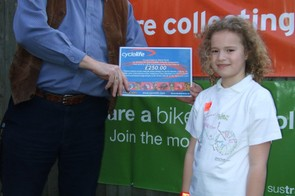Olivia Farah receives her Raleigh bike voucher from her headmaster
