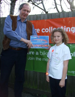 Olivia Farah receives her Raleigh bike voucher from her headmaster