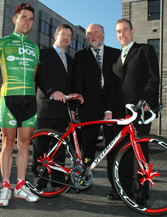 Mark Cassidy and Sean Kelly with representatives from two of the team's main sponsors