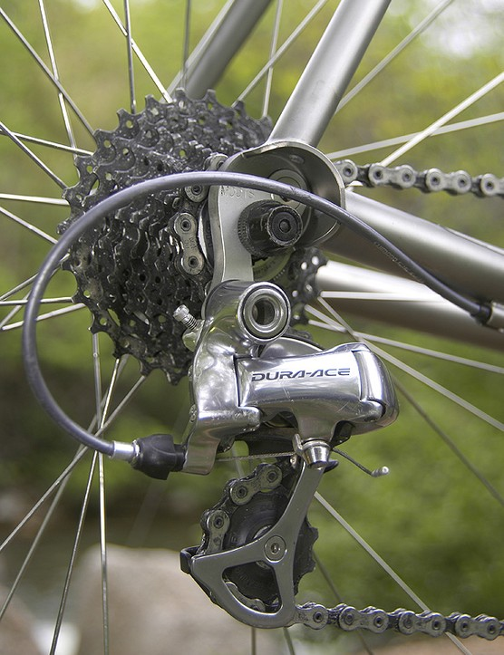 The matching Dura-Ace rear derailleur is fitted to a replaceable hanger.