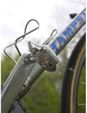 Old-school Dura-Ace SPD pedals allow the use of recessed cleats for easier walking while on tours.