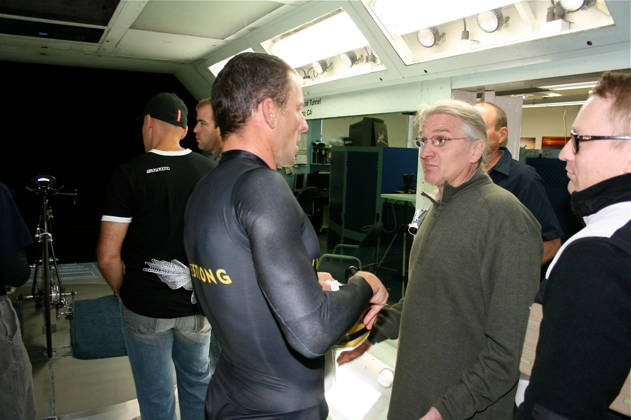 Longtime aerodynamic consultant Steve Hed (C) chats with Armstrong in the San Diego wind tunnel November 4.