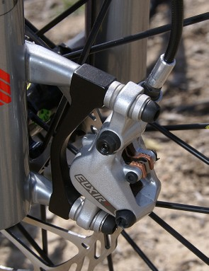 The new two-piece calliper uses bigger pistons for more power and top-loaded pads.