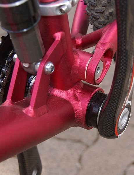 The larger diameter shell  won't allow for the broad down tubes & wide chain stays of some designs