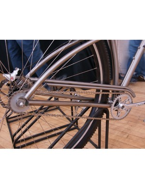 A twin-tubed titanium chain guard is cleanly fitted