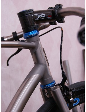 The frame is TIG-welded but careful masking and blasting yields a faux lugged look