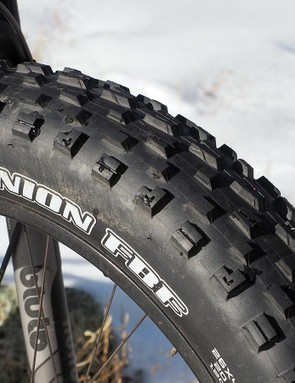 The Maxxis Minion FBF/FBR tires' huge footprint and monstrous tread lend phenomenally good traction, just as you'd expect. However, they're also noticeably heavy and very slow rolling