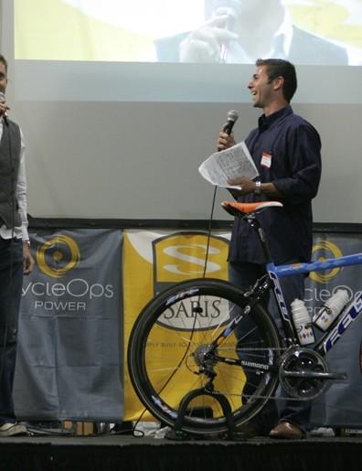 Garmin-Chipotle rider Christian Vande Velde on stage with former US Postal rider Robbie Ventura.