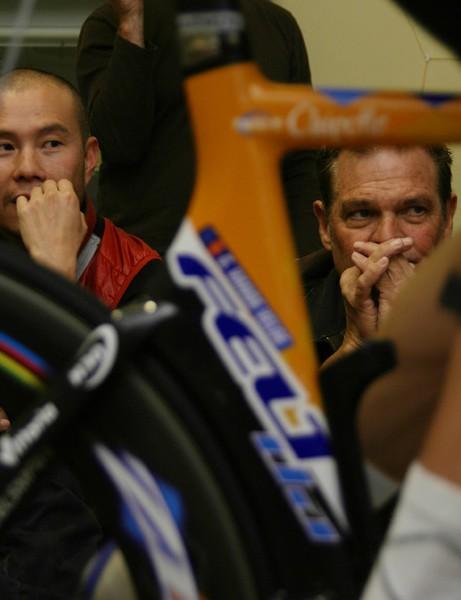 Allen Lim and Jim Felt look on intently as Vande Velde is set up