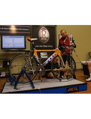 Garmin-Chipotle team physiologist Allen Lim and physical therapist - and bicycle coach - Curtis Cramblett take some measurements the old-fashioned way